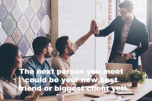 Two men high fiving each other with text. The next person you meet could be your new best friend or biggest client yet.