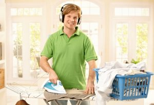 man-in-green-shirt-ironing-500x342